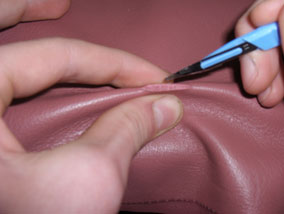 Cut in Leather getting repaired