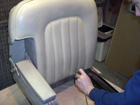 how to change the colour of a leather car interior - Spraying the colour on